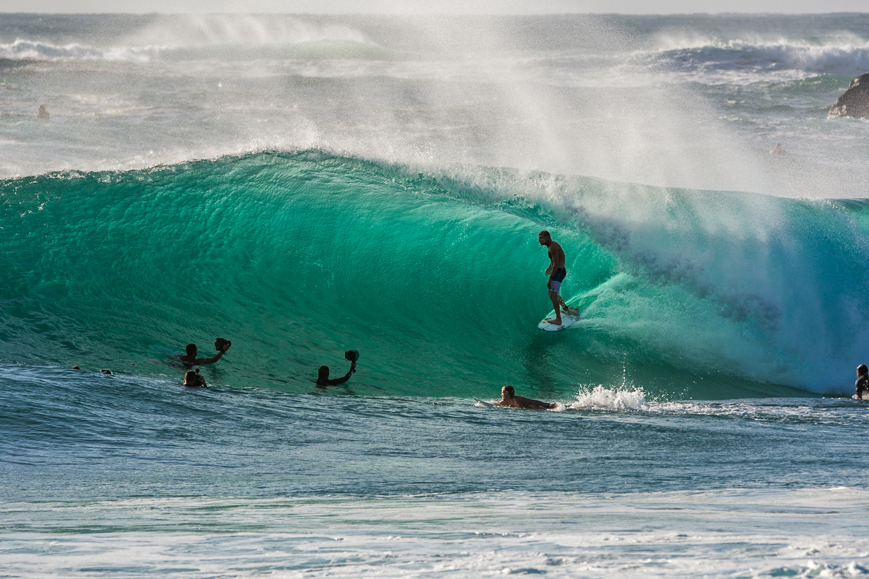 people surfing on waves