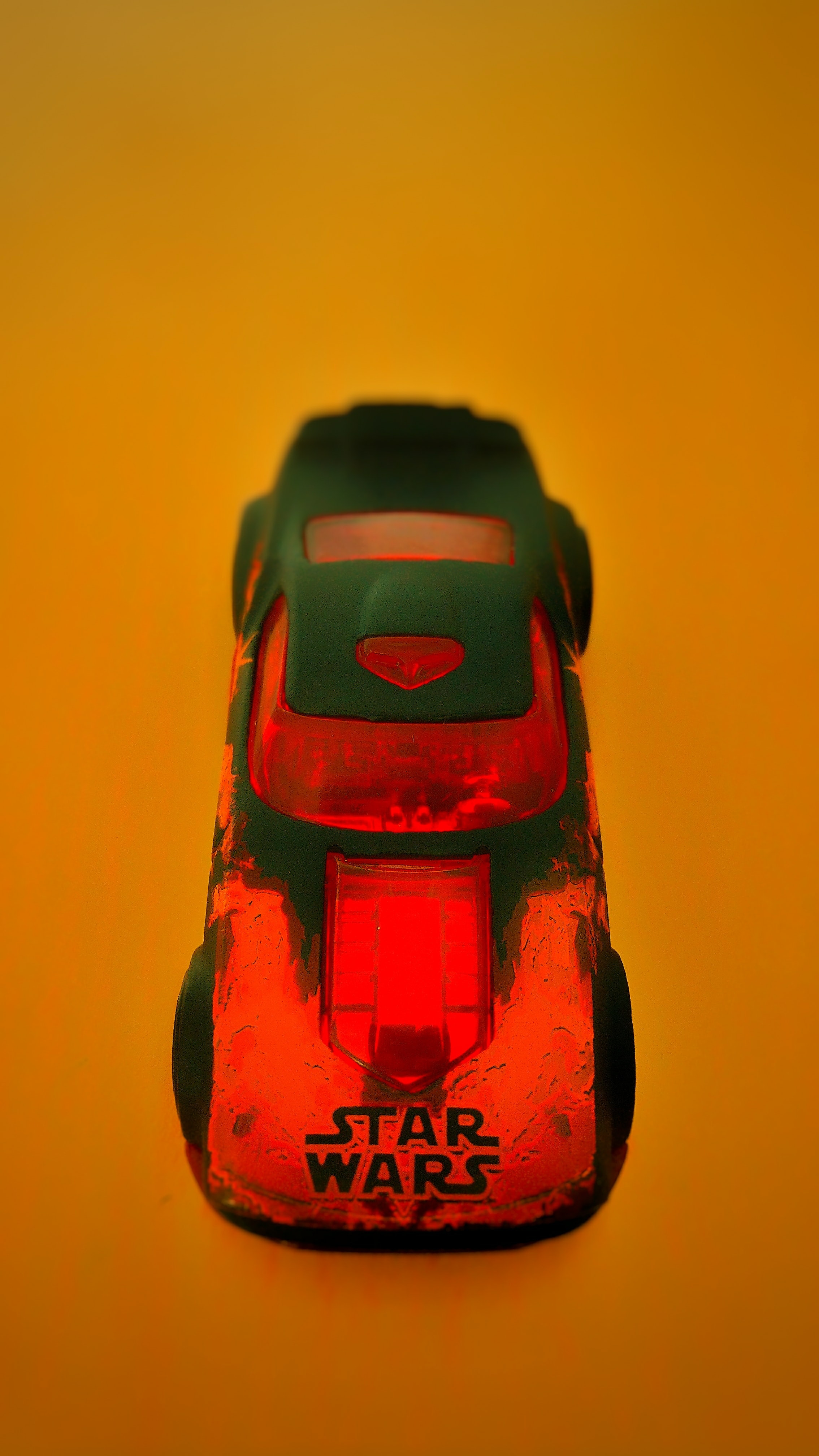 A Star Wars car on an orange surface.