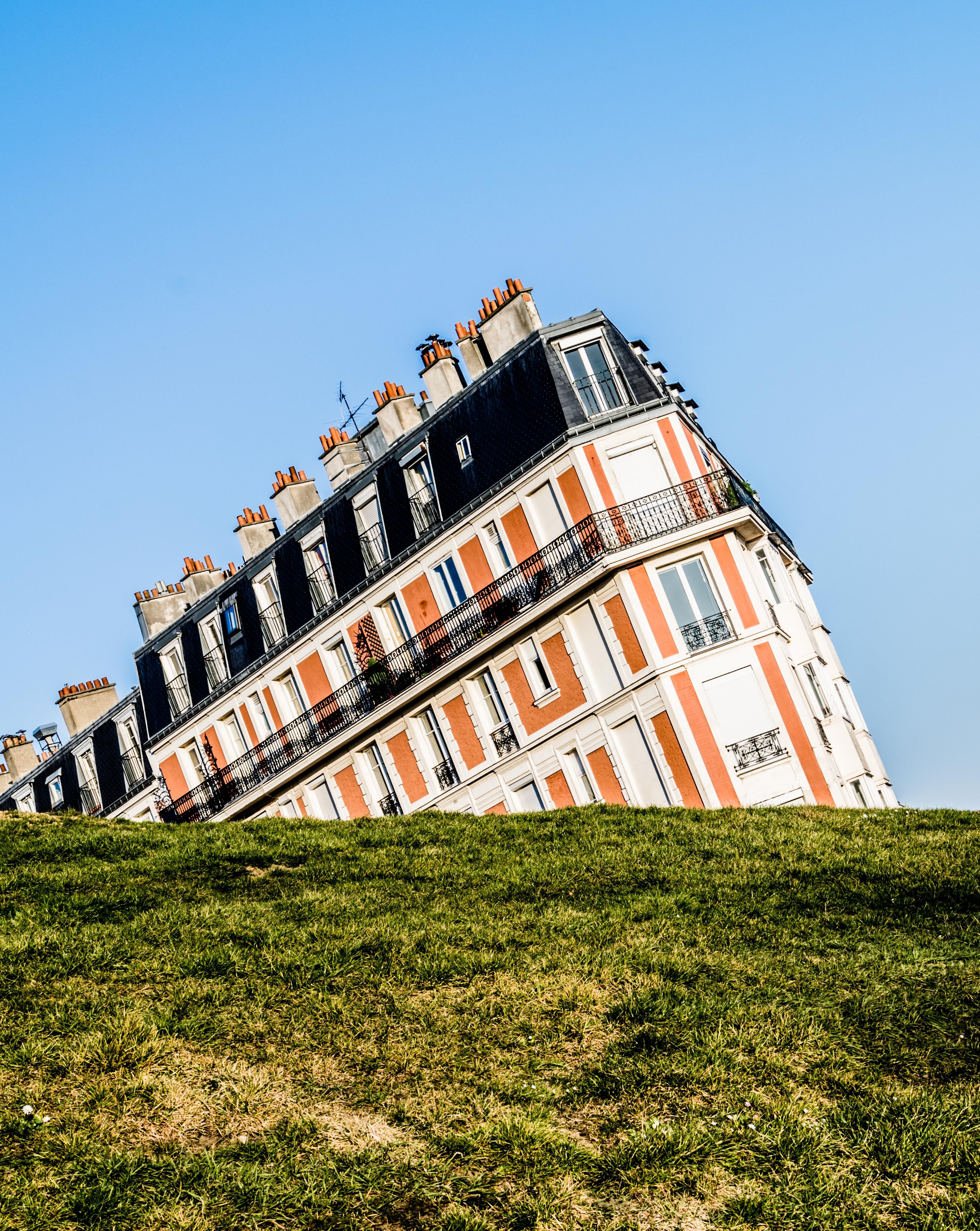 An angular shot of an apartment building with French architecture in Paris.