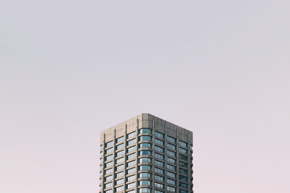 grey and blue high-rise building