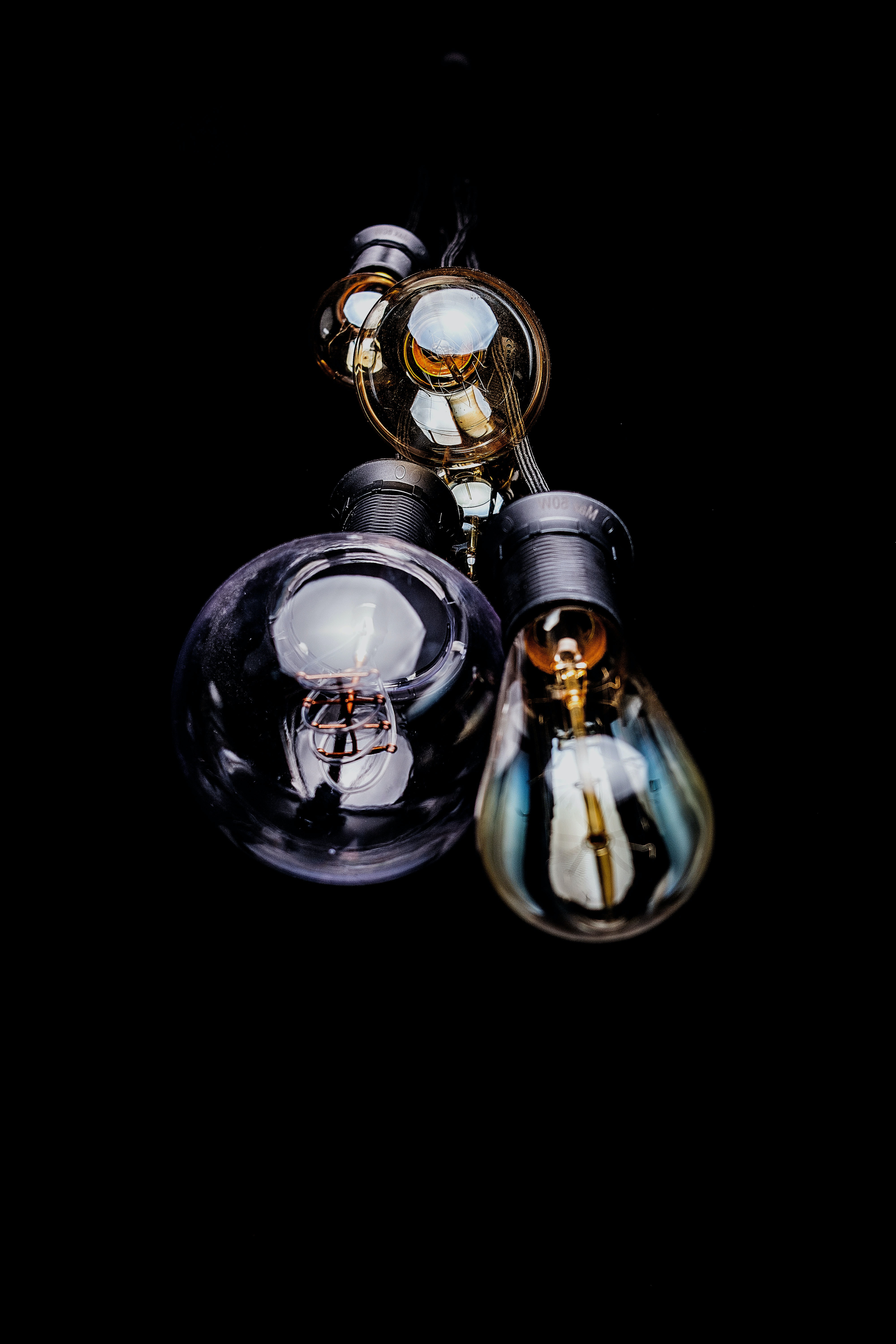 A close-up of the light bulbs against the black background in Cascais.