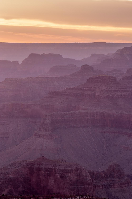 brown mountains under sunset