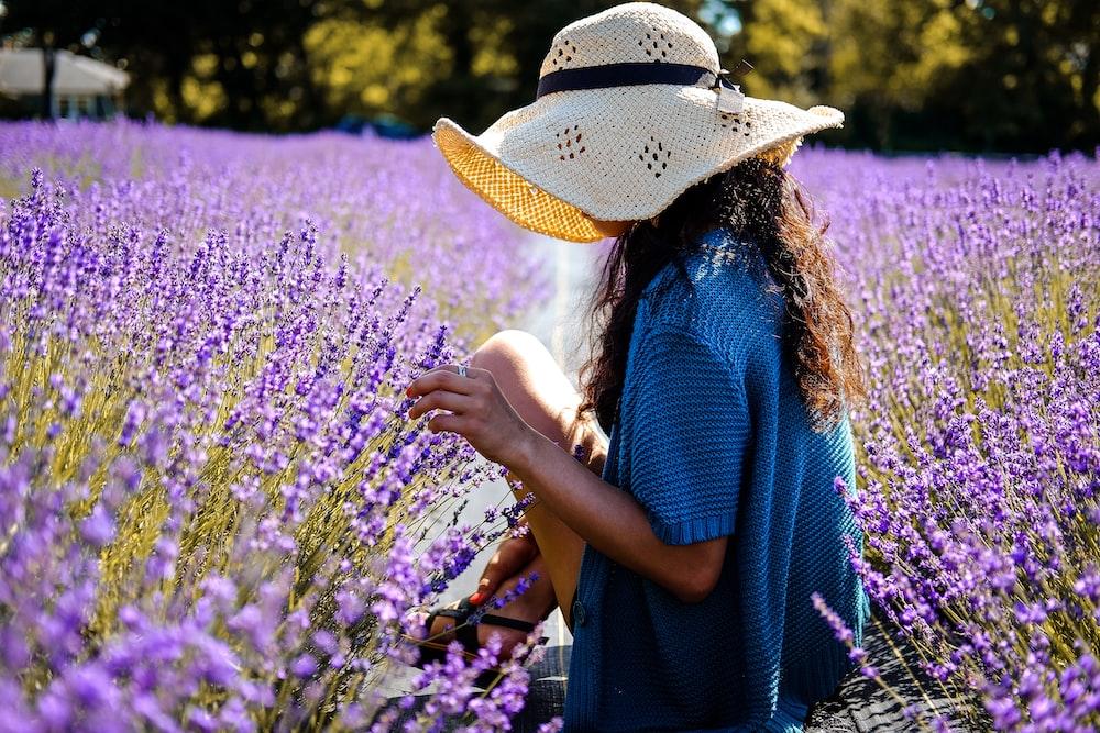 woman in between on purple lavender field taken at daytime