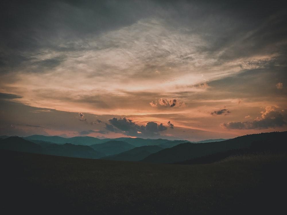 hills landscape during sunset