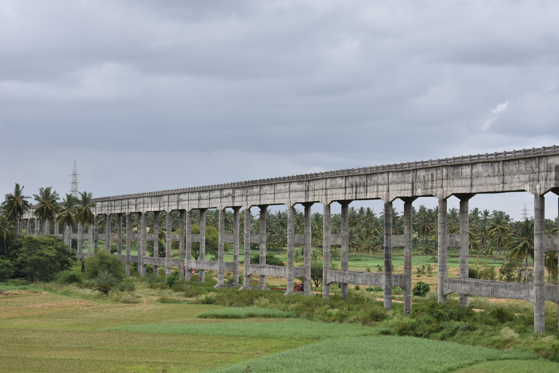Concrete bridge over a lush green landscape