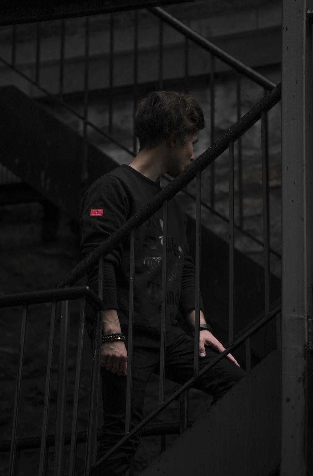 man stand on black metal stair