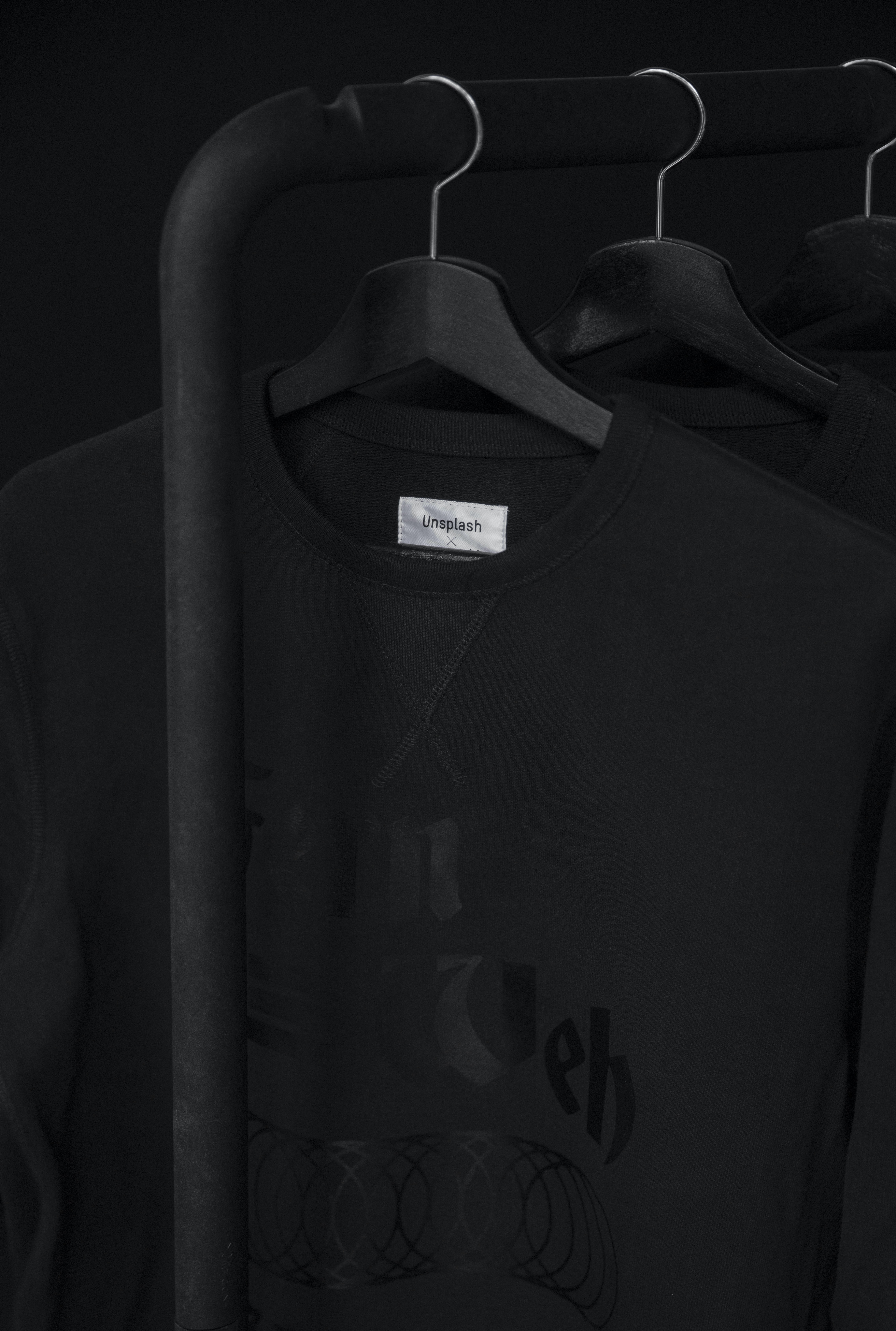 black crew-neck t-shirt on clothes hanger