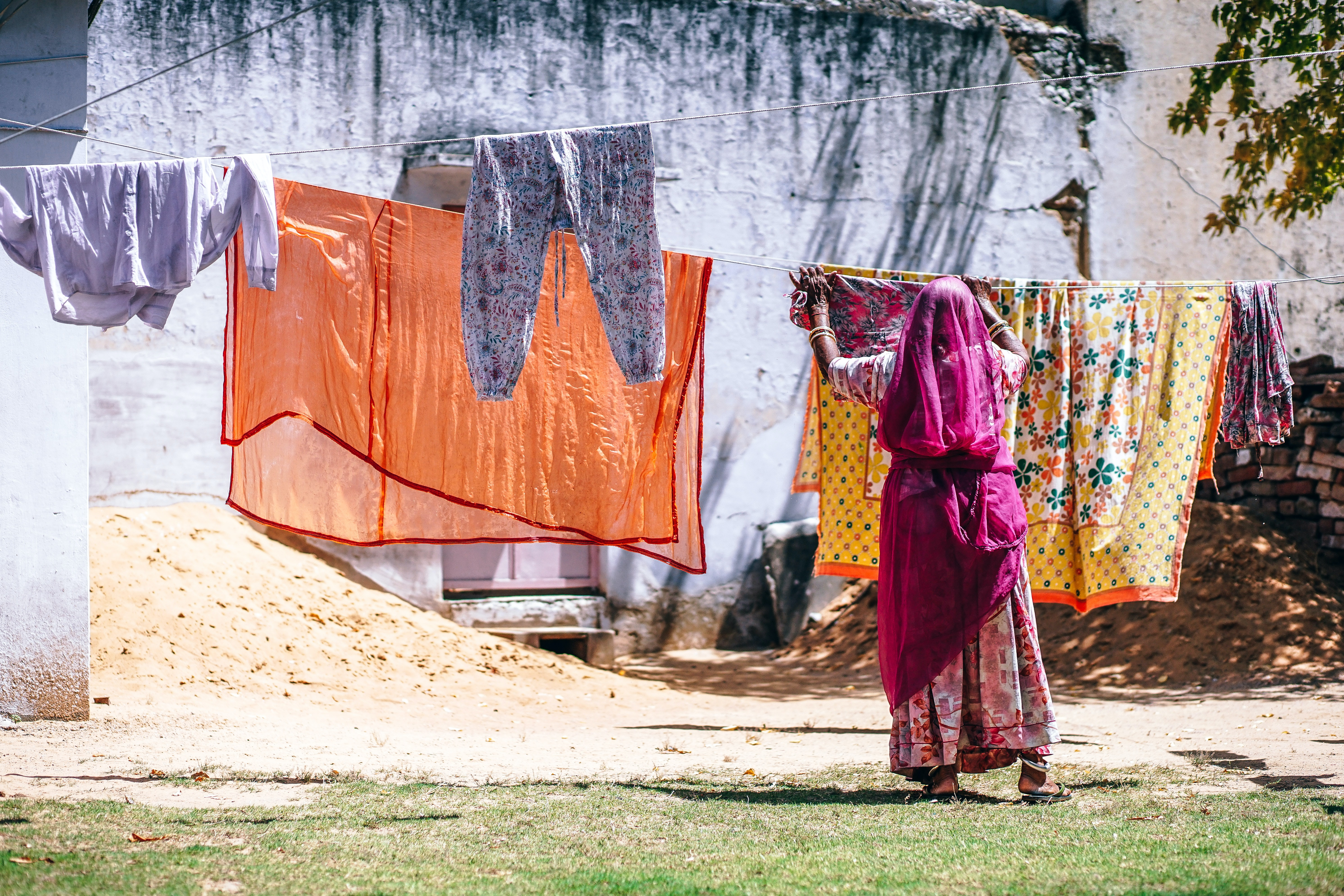 Woman hanging colorful laundry on the line in Pushkar