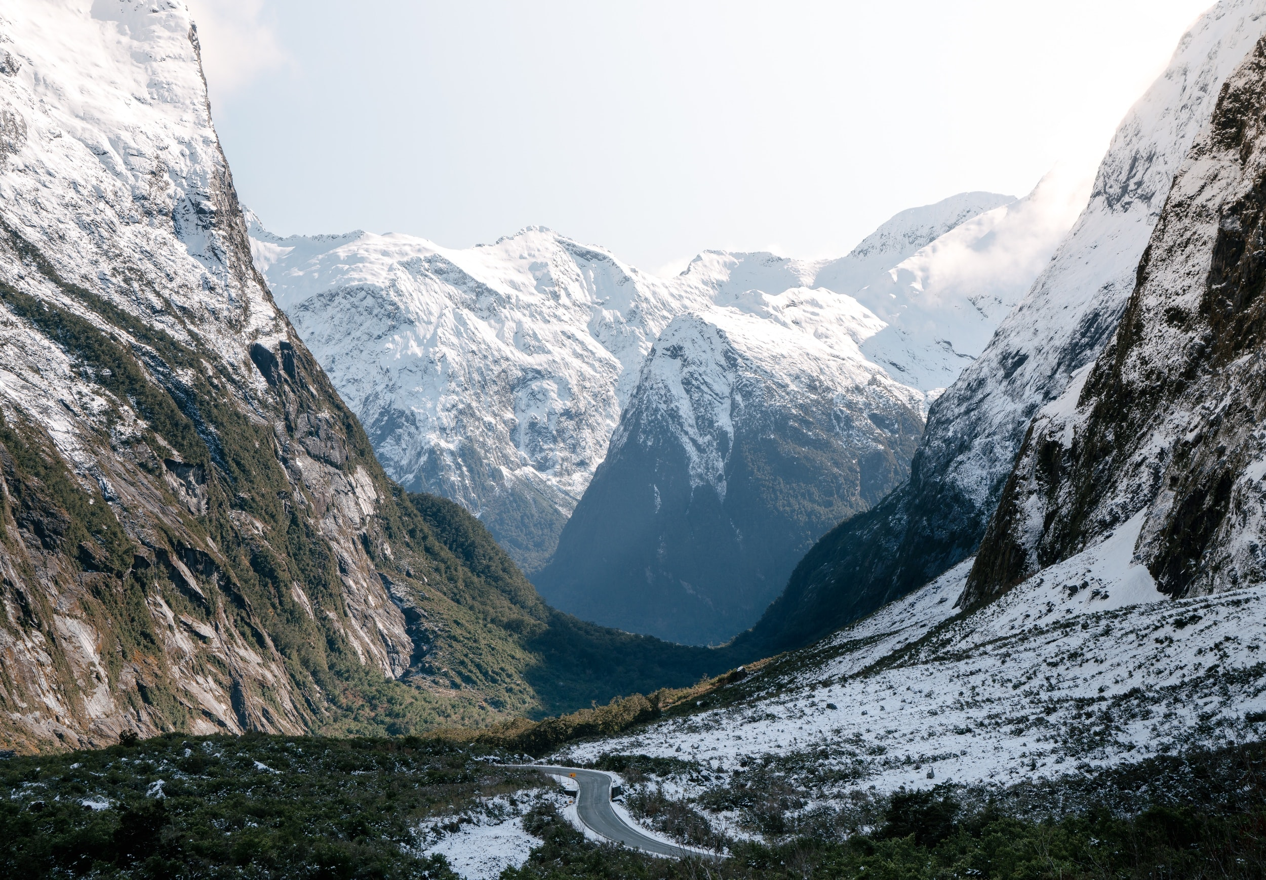 Mountain valley landscape with snowcapped peaks