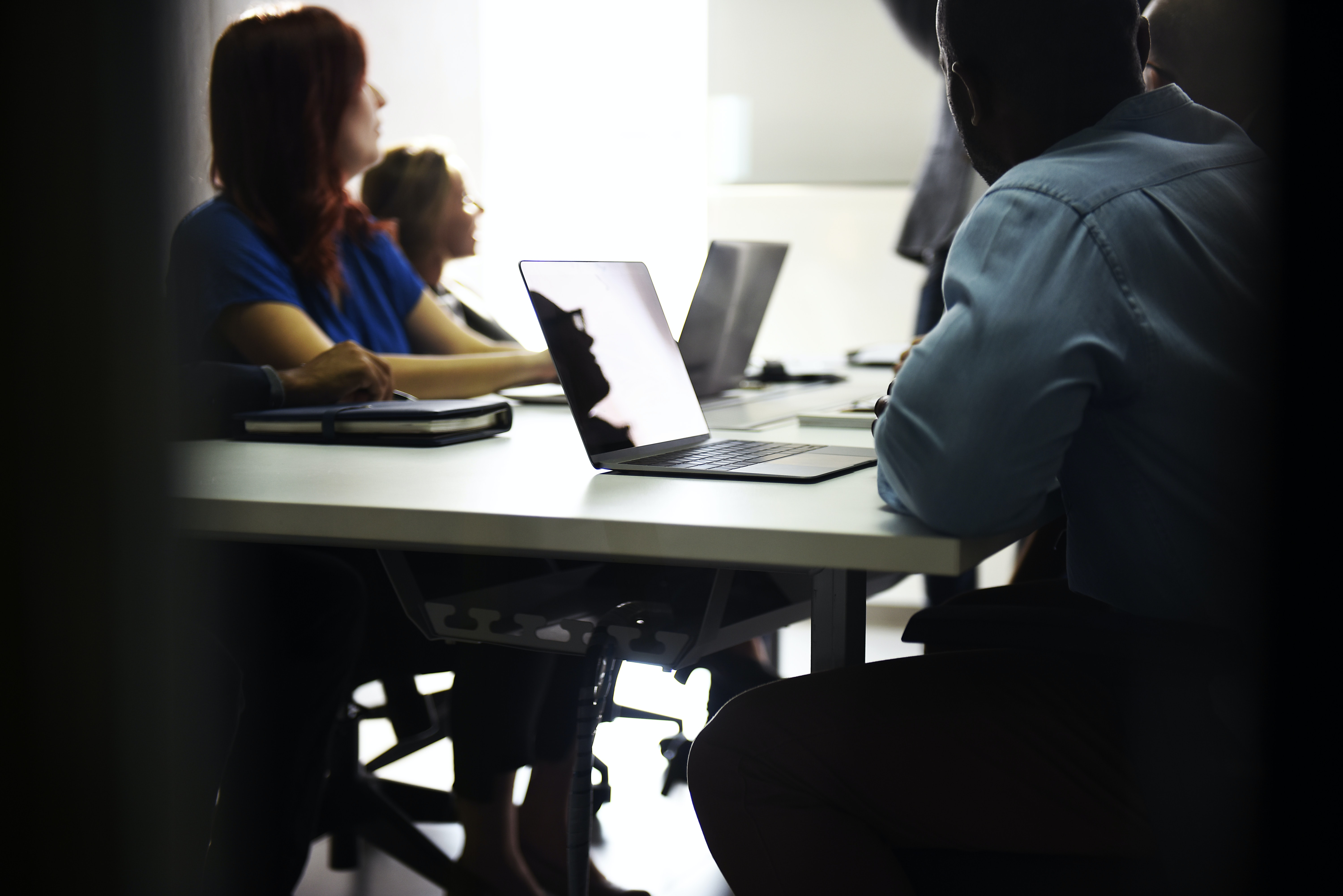 A group of office workers conducting a meeting.