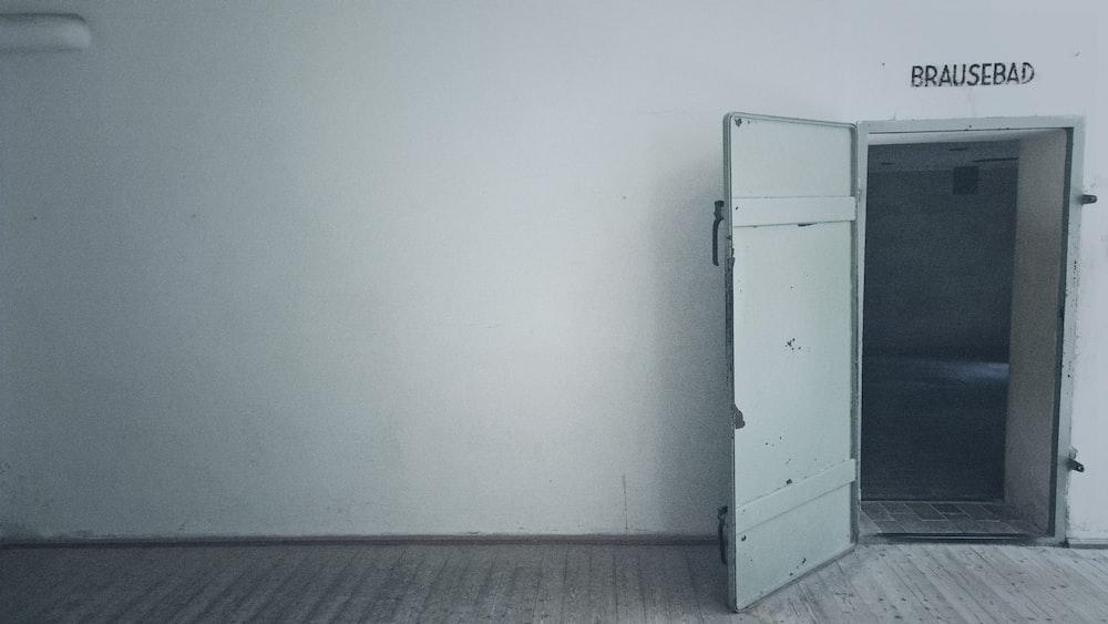 open gray wooden door
