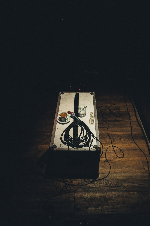 closeup photo of microphone on gray box