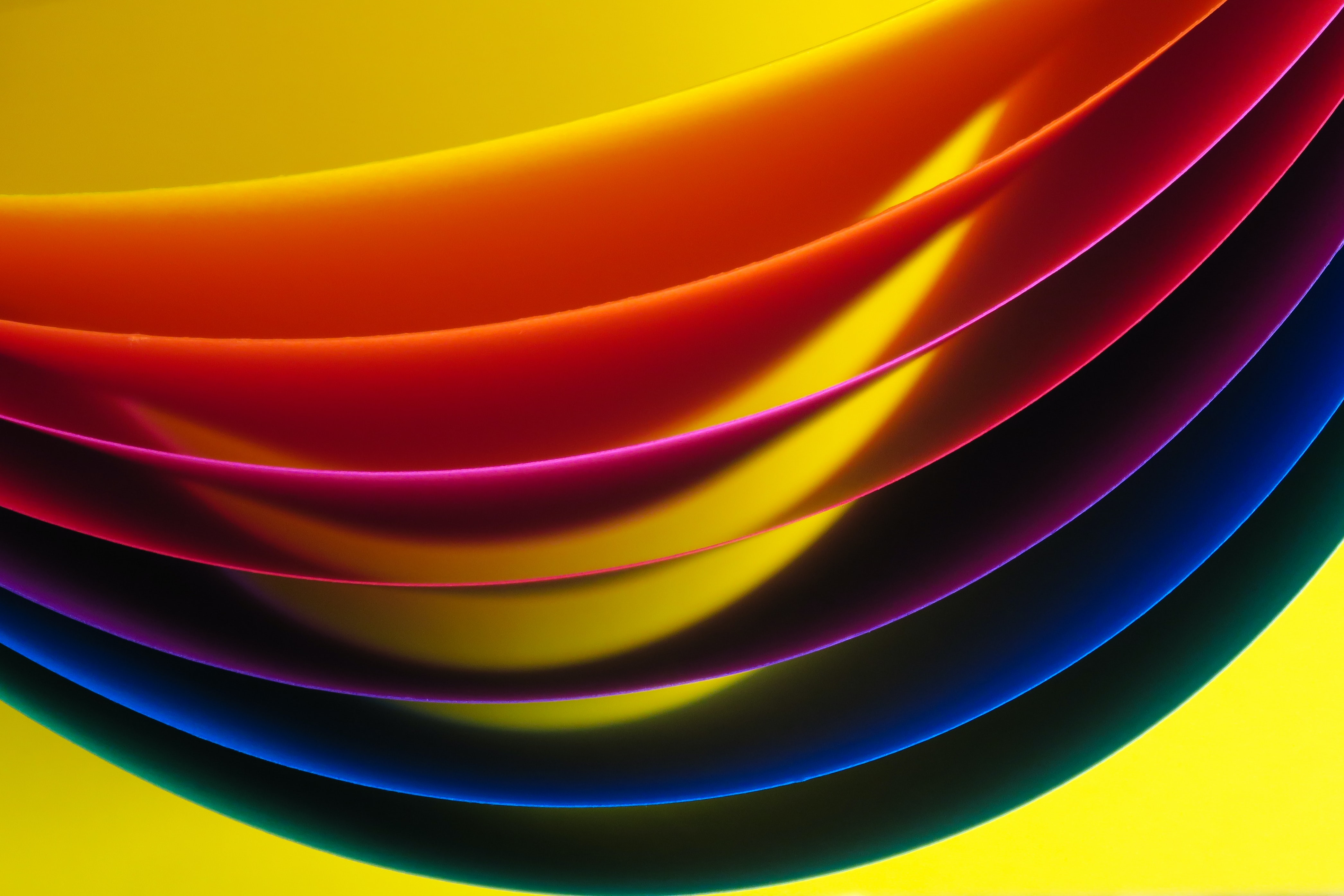 yellow, red, purple, blue, and green layer paper wallpaper