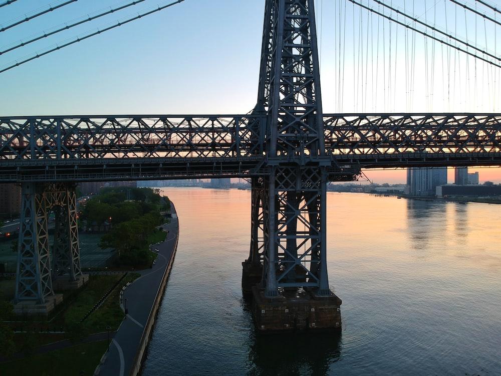 gray metal suspension bridge during daytime