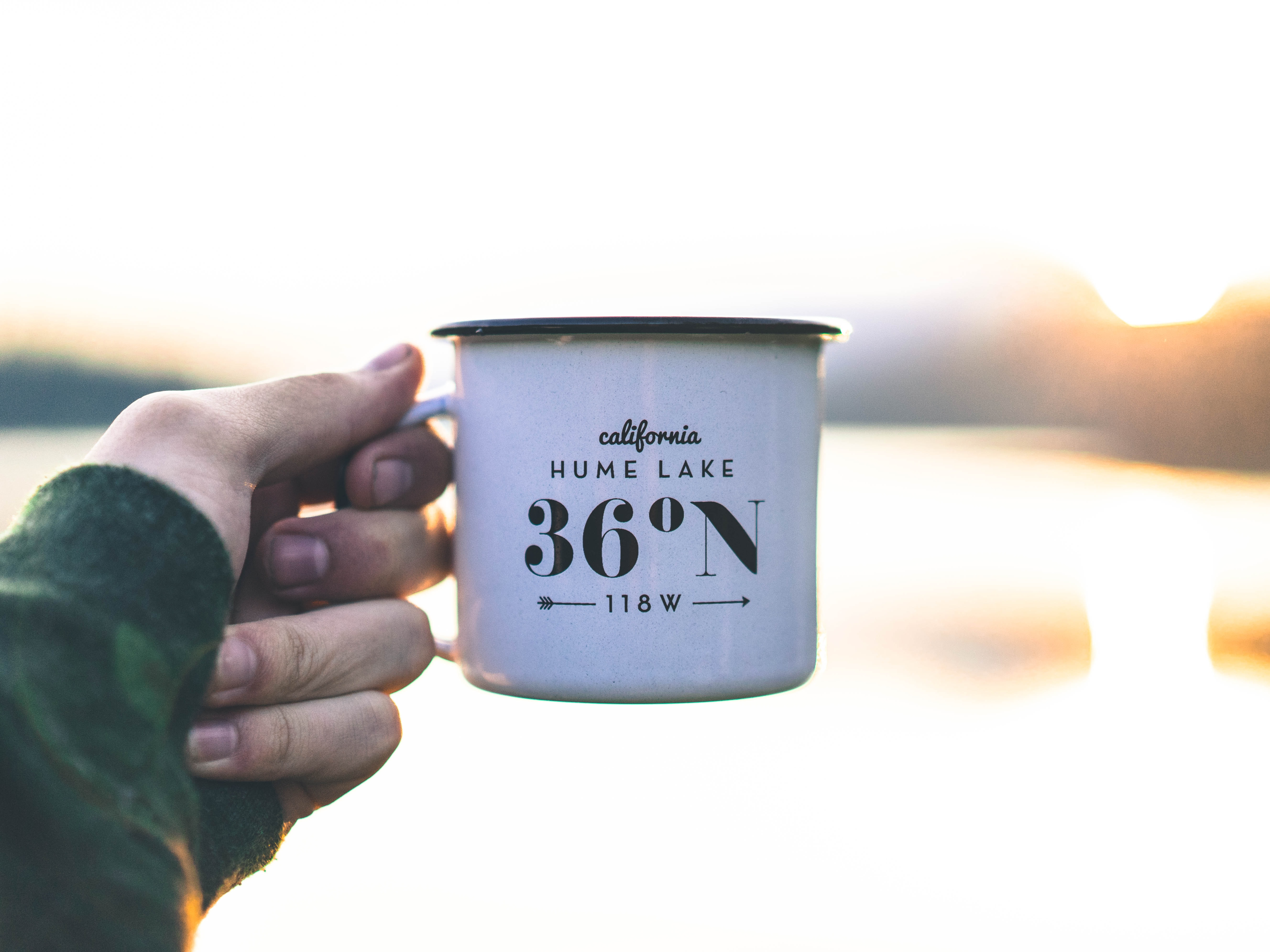 white and black steel cup