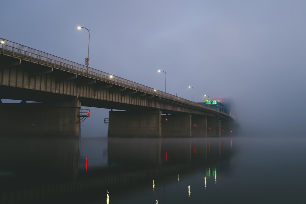bridge covered with thick fog during daytime