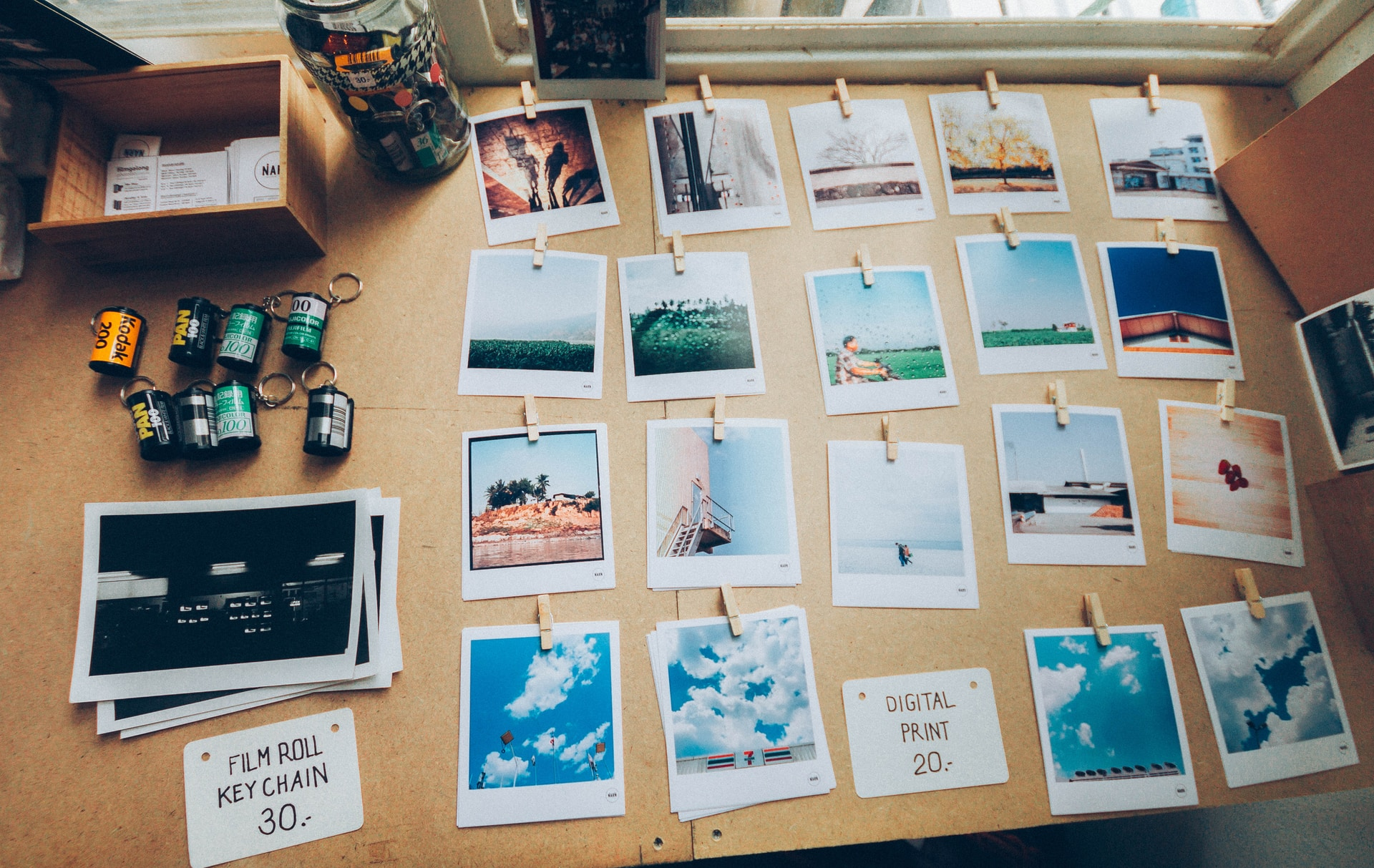 assorted photos on beige wooden table