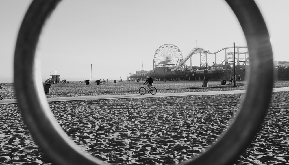 grayscale photography of person riding bike