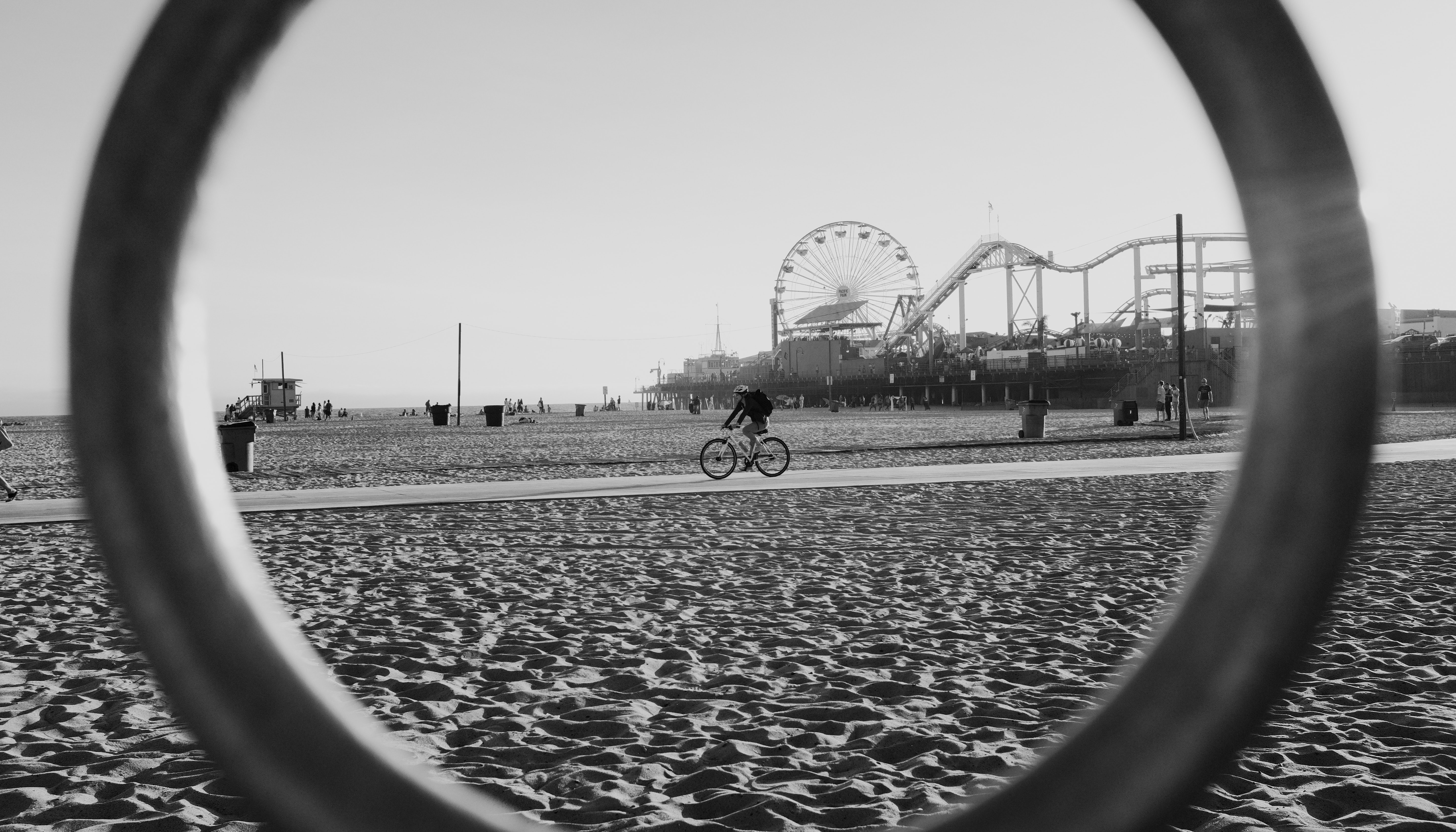 View of the cyclist on the beach sand path by the Santa Monica Pier