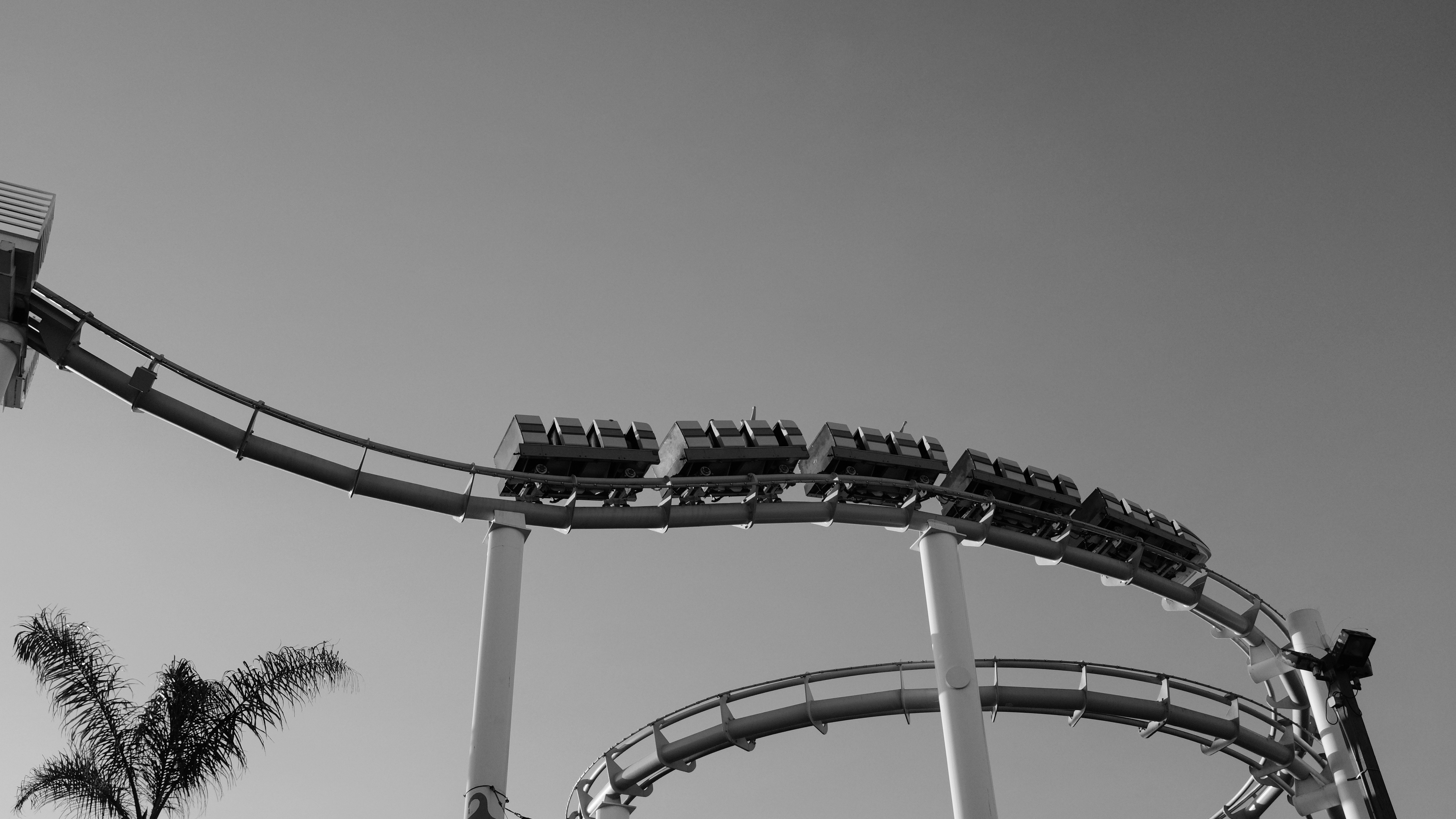 Black and white shot of roller coaster and clear sky at Santa Monica Pier