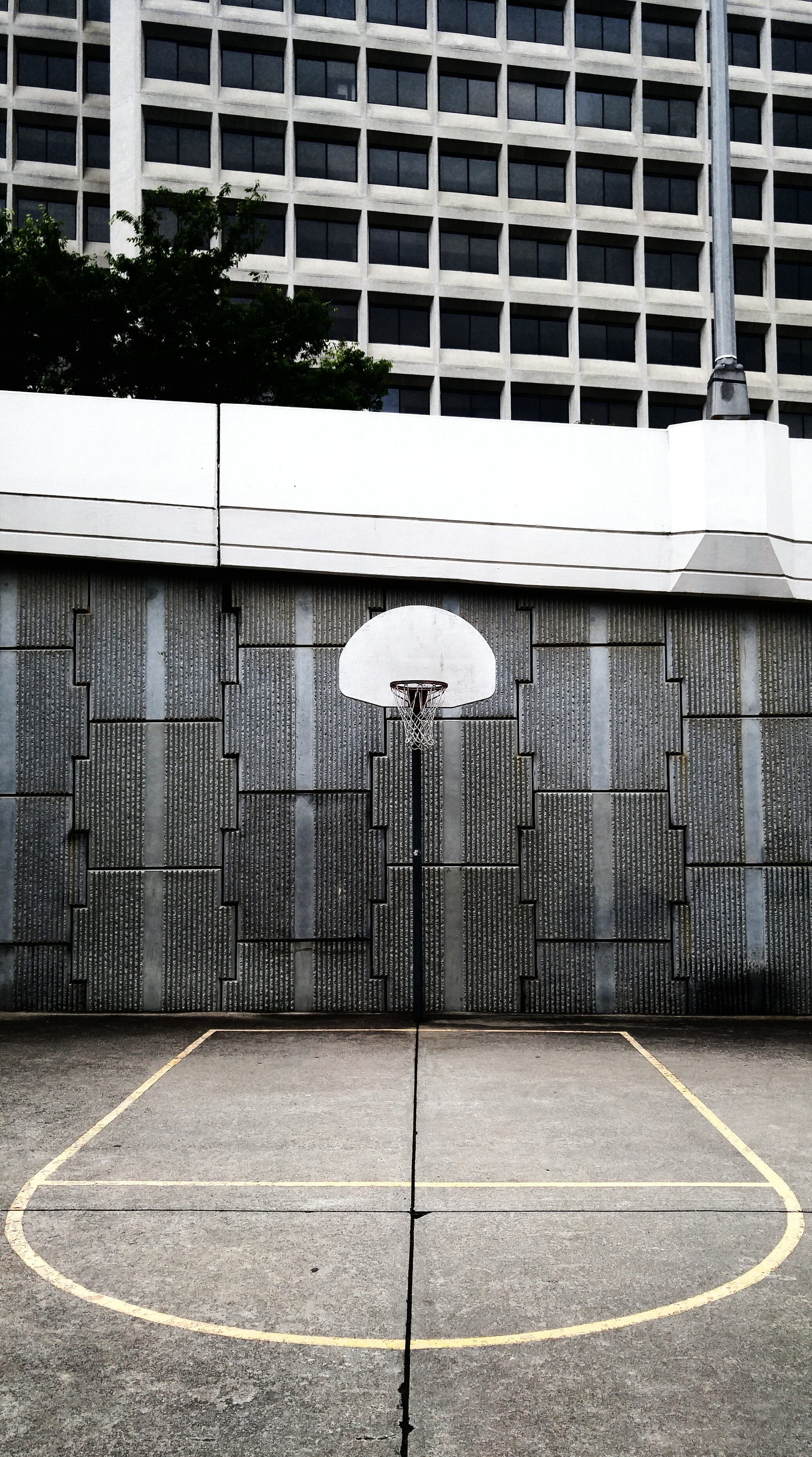 landscape photo of portable basketball hoop on court