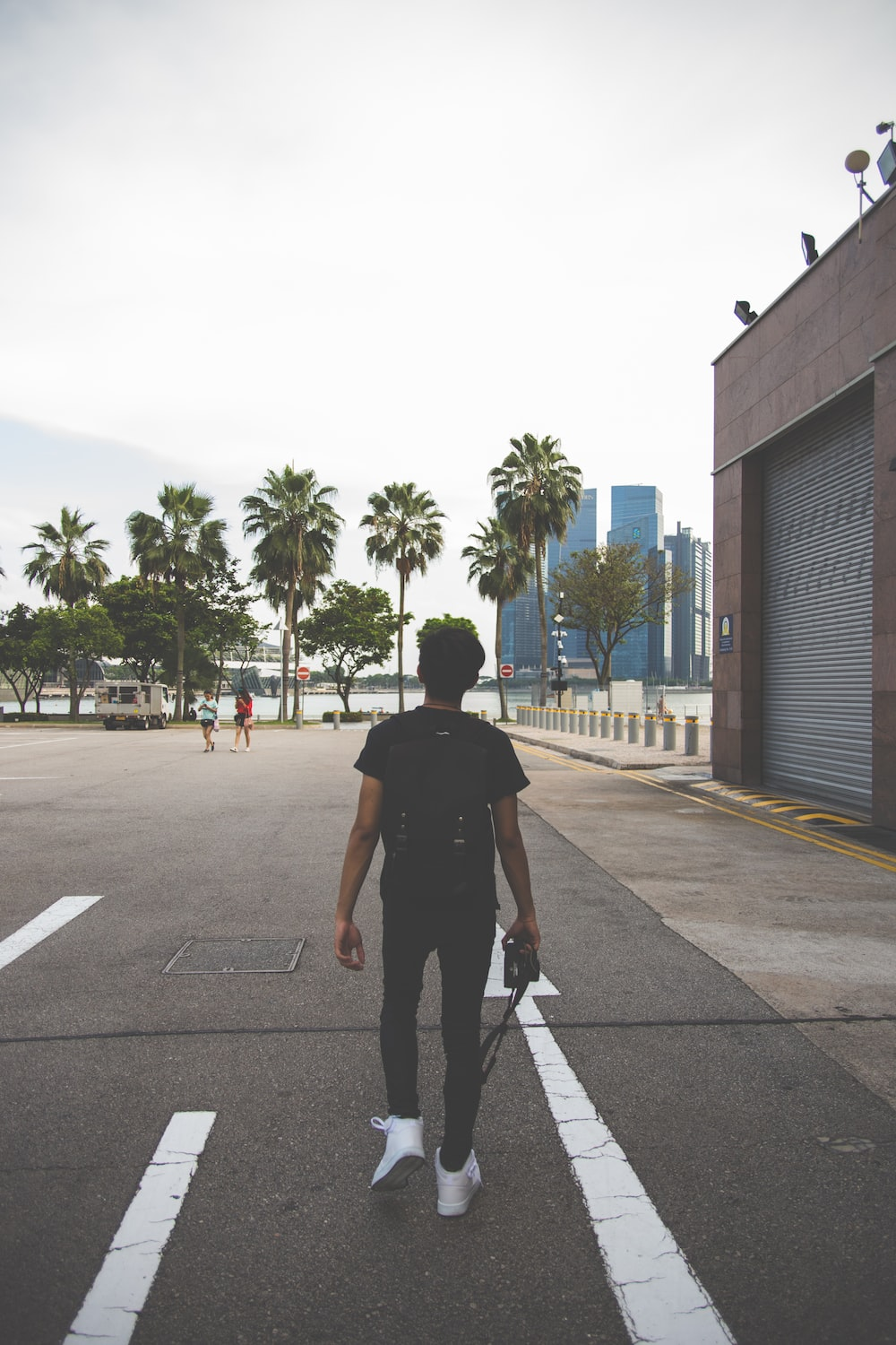 man in black t-shirt on gray concrete road