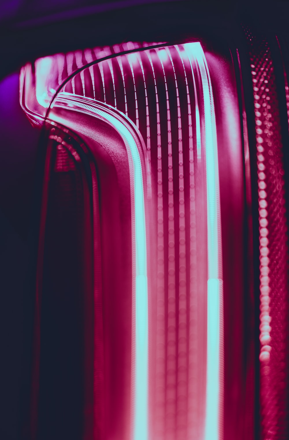 Close-up of glowing lines in a pink neon