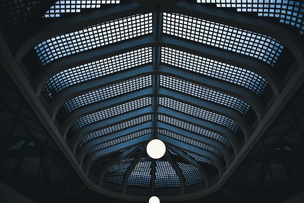 low angle photography of mesh wall