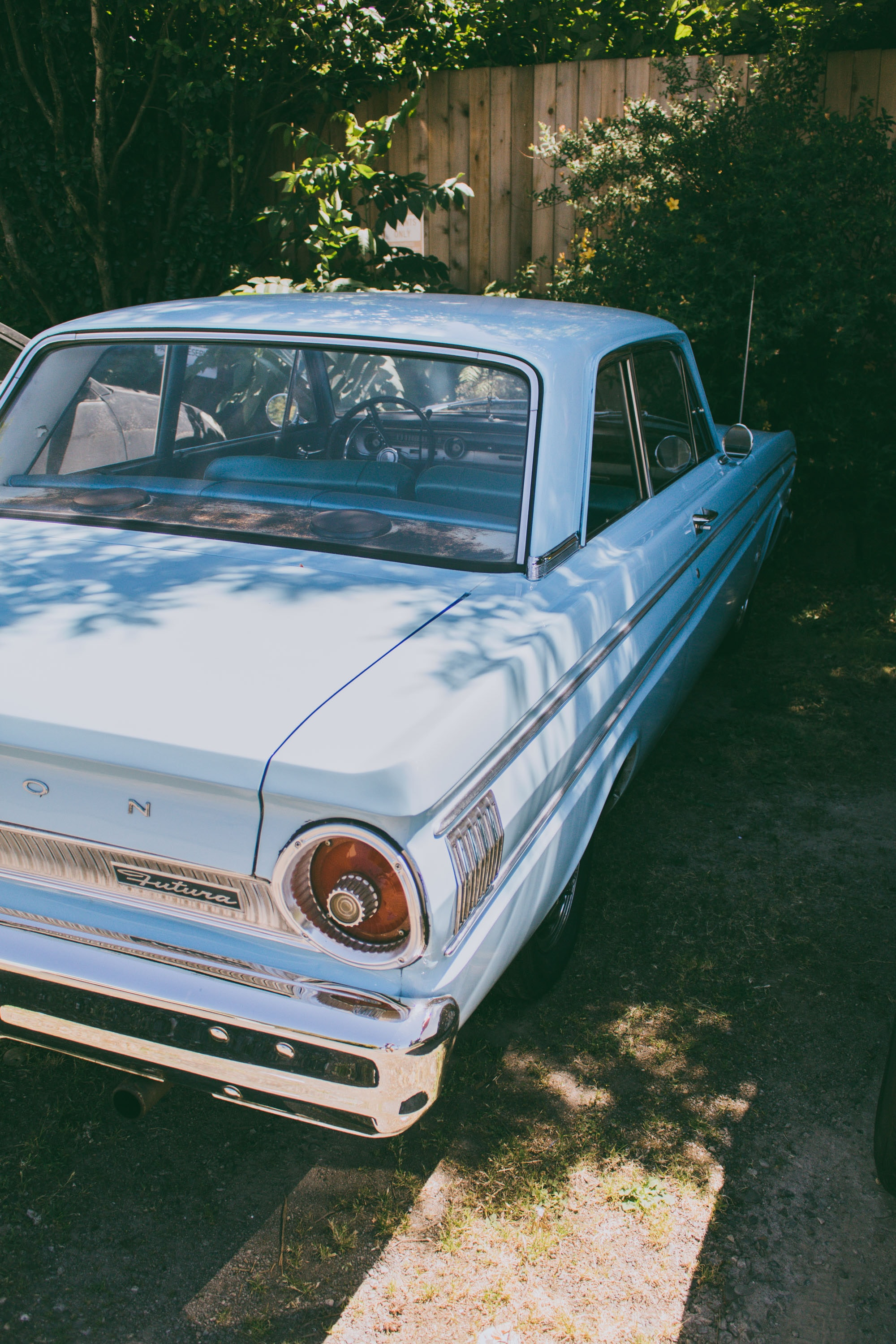 photography of classic white vehicle