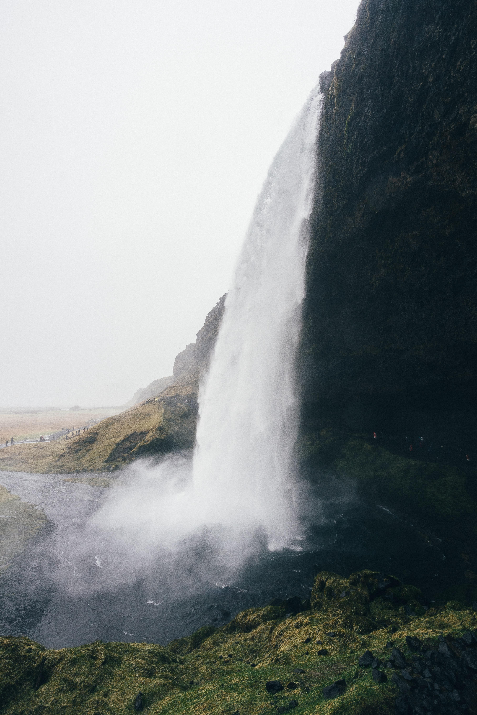 Cascading Seljalandsfoss Waterfall drops off misty cliff