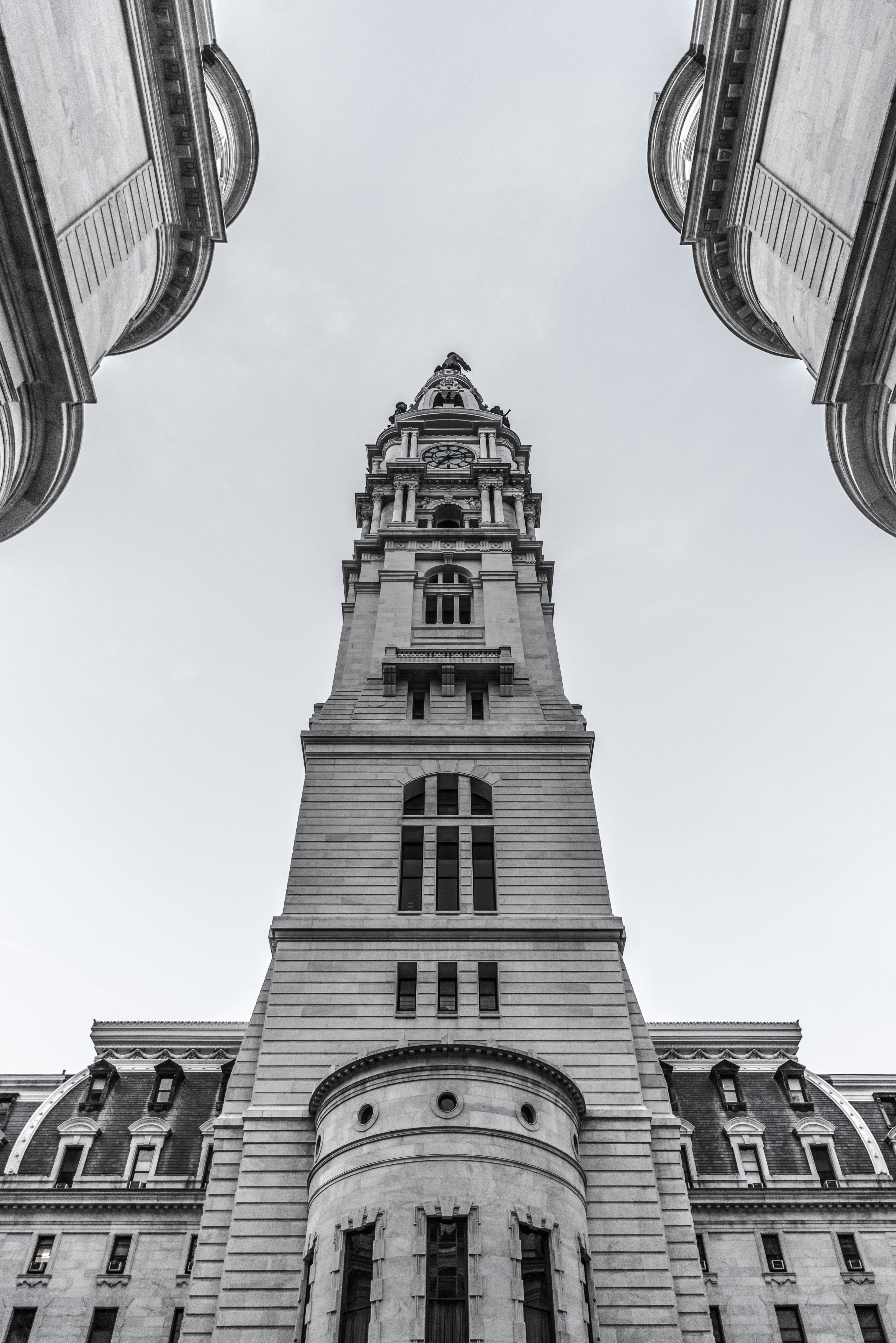 Black and white shot of large gothic building with tower and clear sky, Philadelphia City Hall
