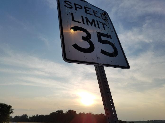 white road signage