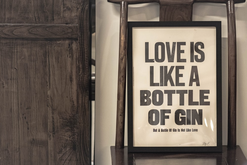 love is like a bottle of gin signage