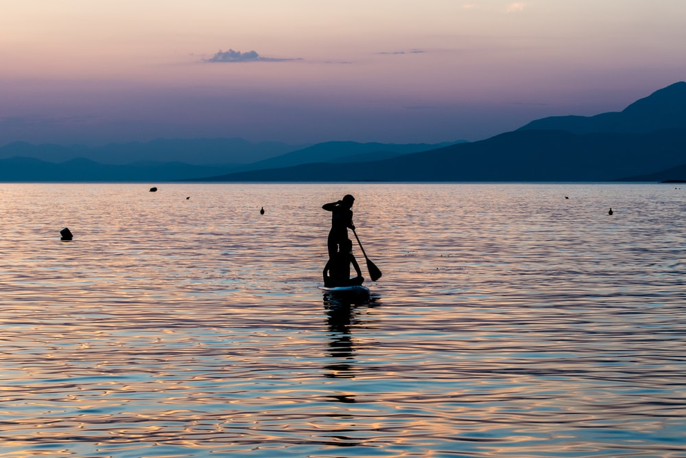 silhouette of person riding on boat