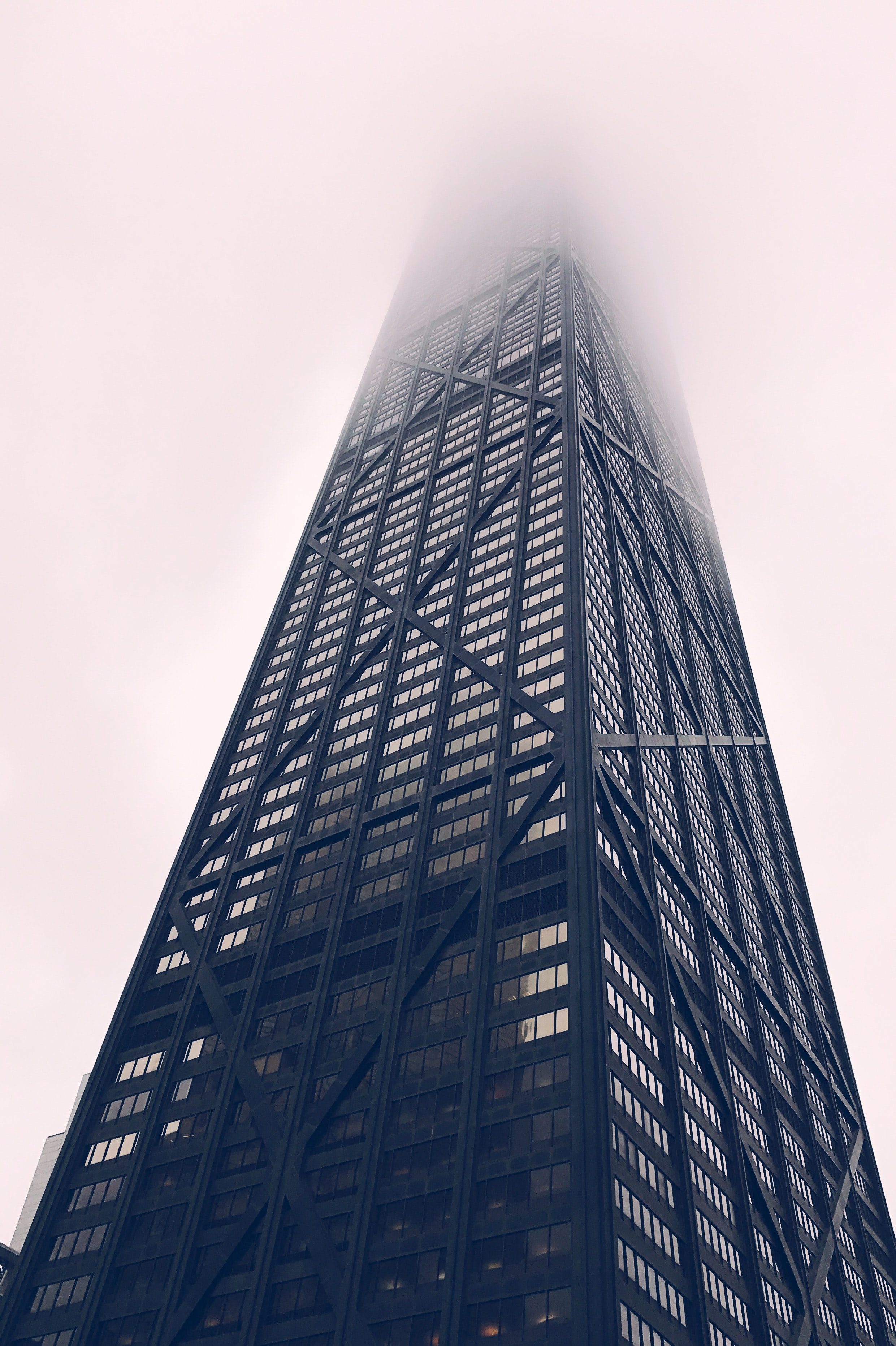 City building in Chicago disappears into the foggy sky