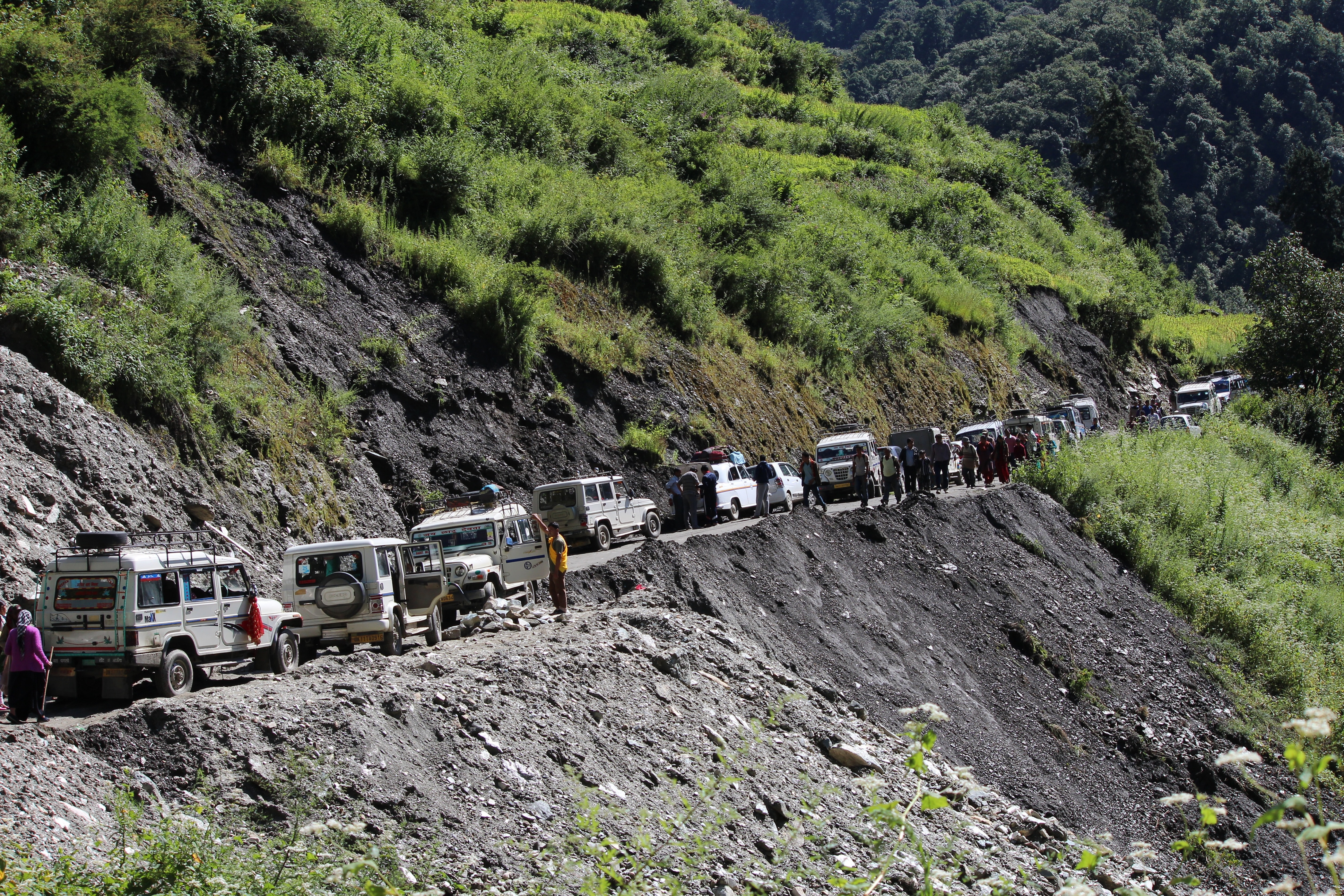 cars crossing near cliff