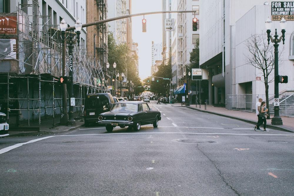 car on road between buildings