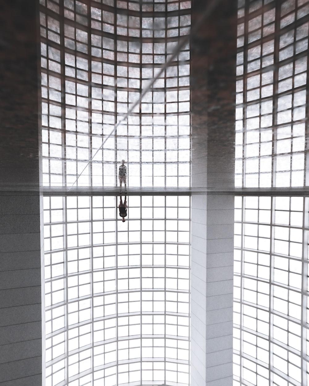 person standing inside concrete building