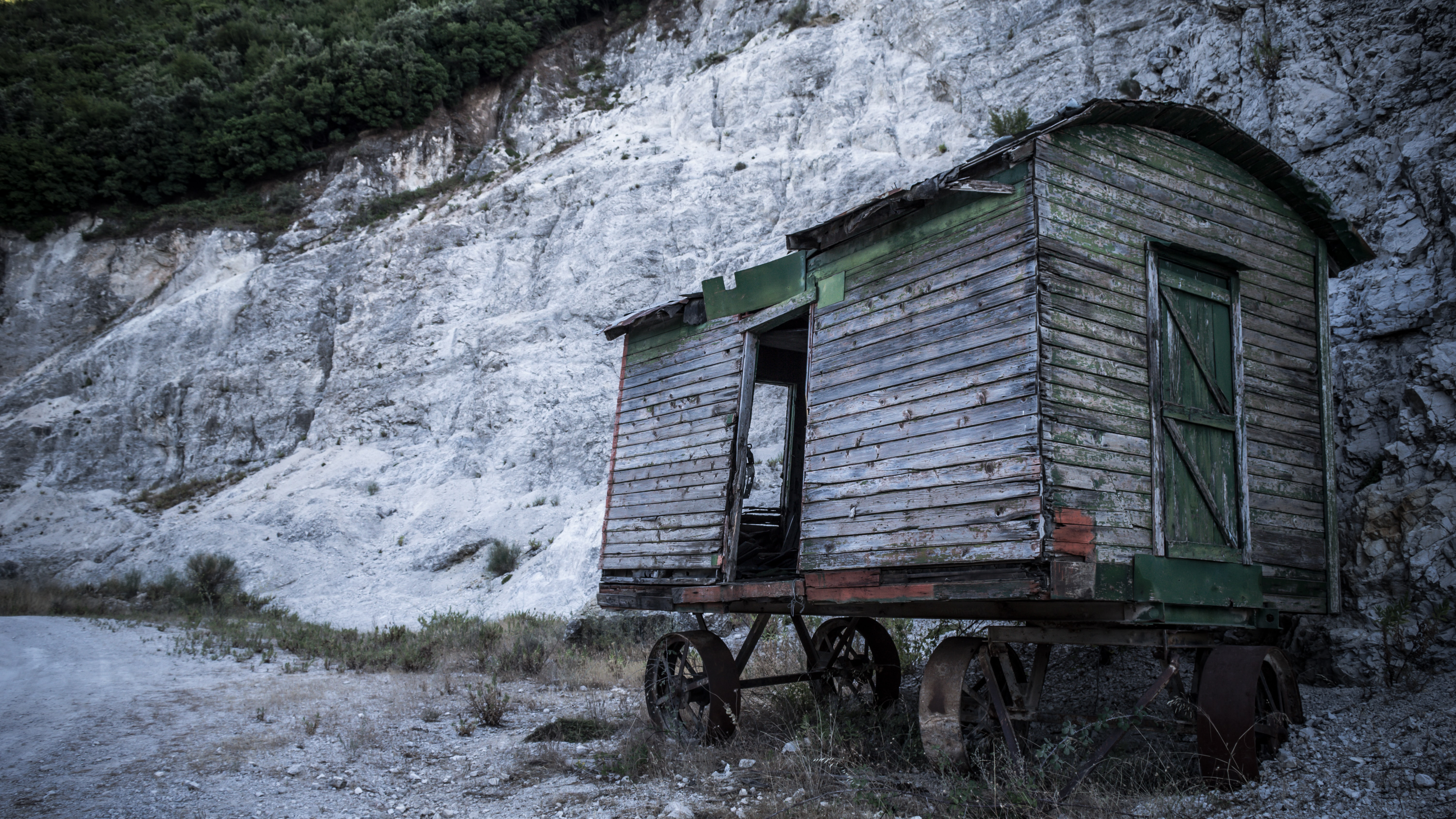 gray wooden house on carriage