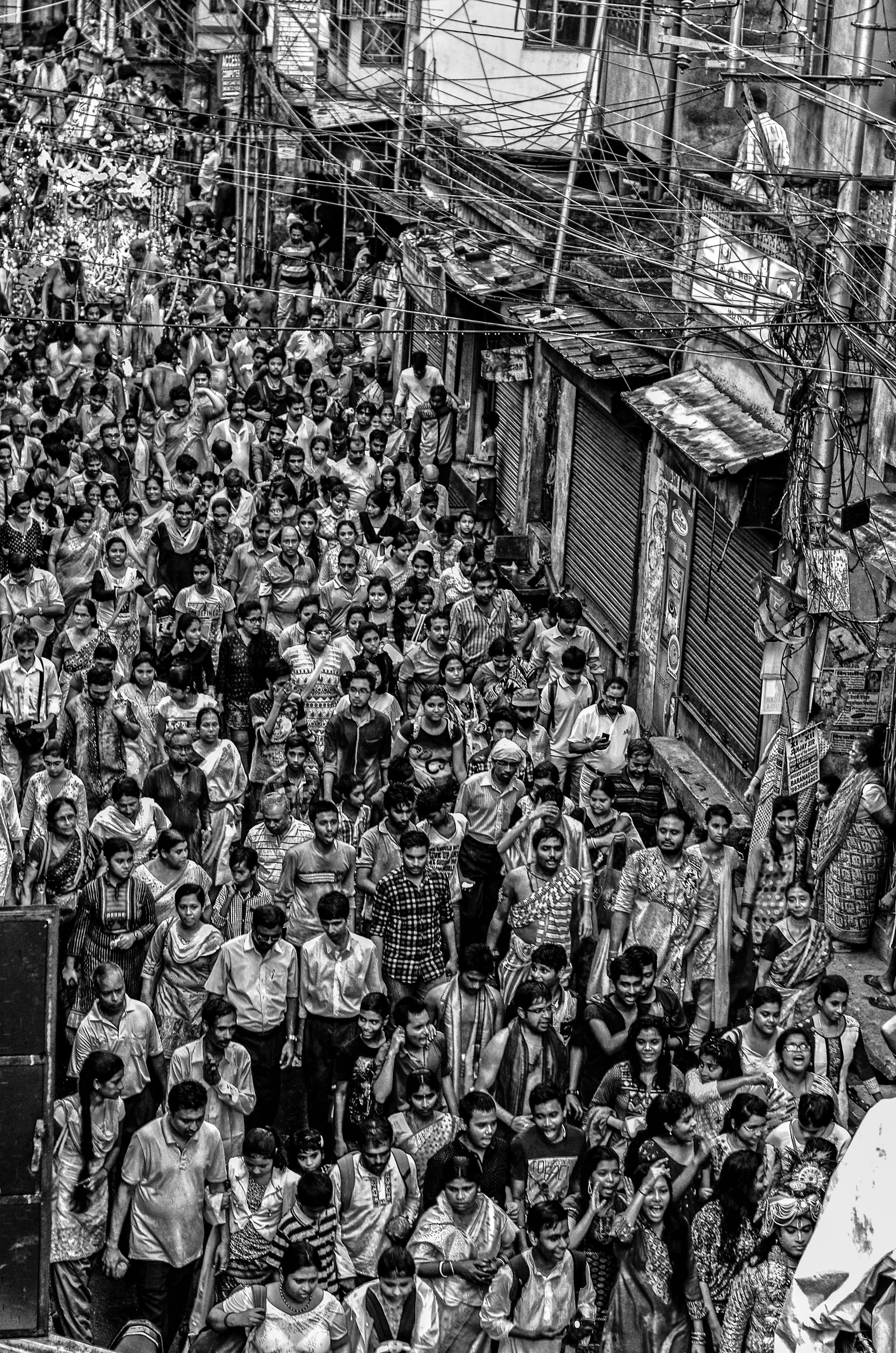 graysale photography of people during parade