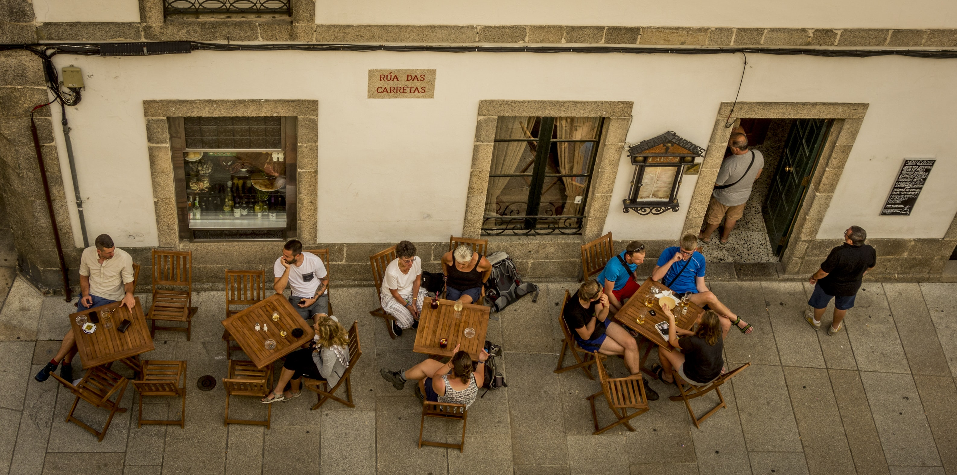 Looking down people eating at an open air cafe in Spain