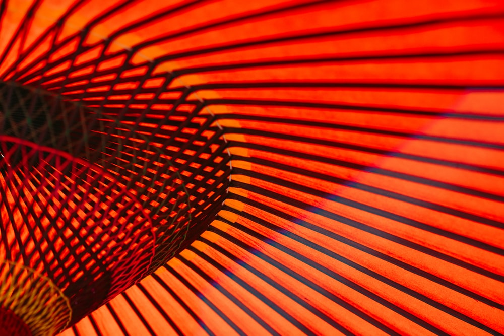 An abstract photo of orange neon lines and rails along the walls in an Asakusa building
