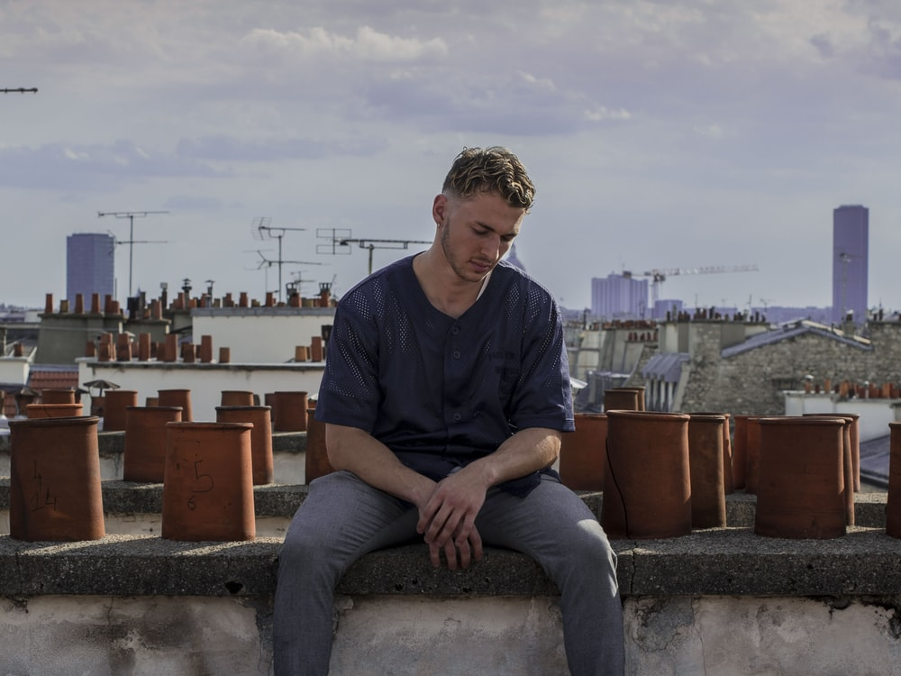 man sitting on roof deck