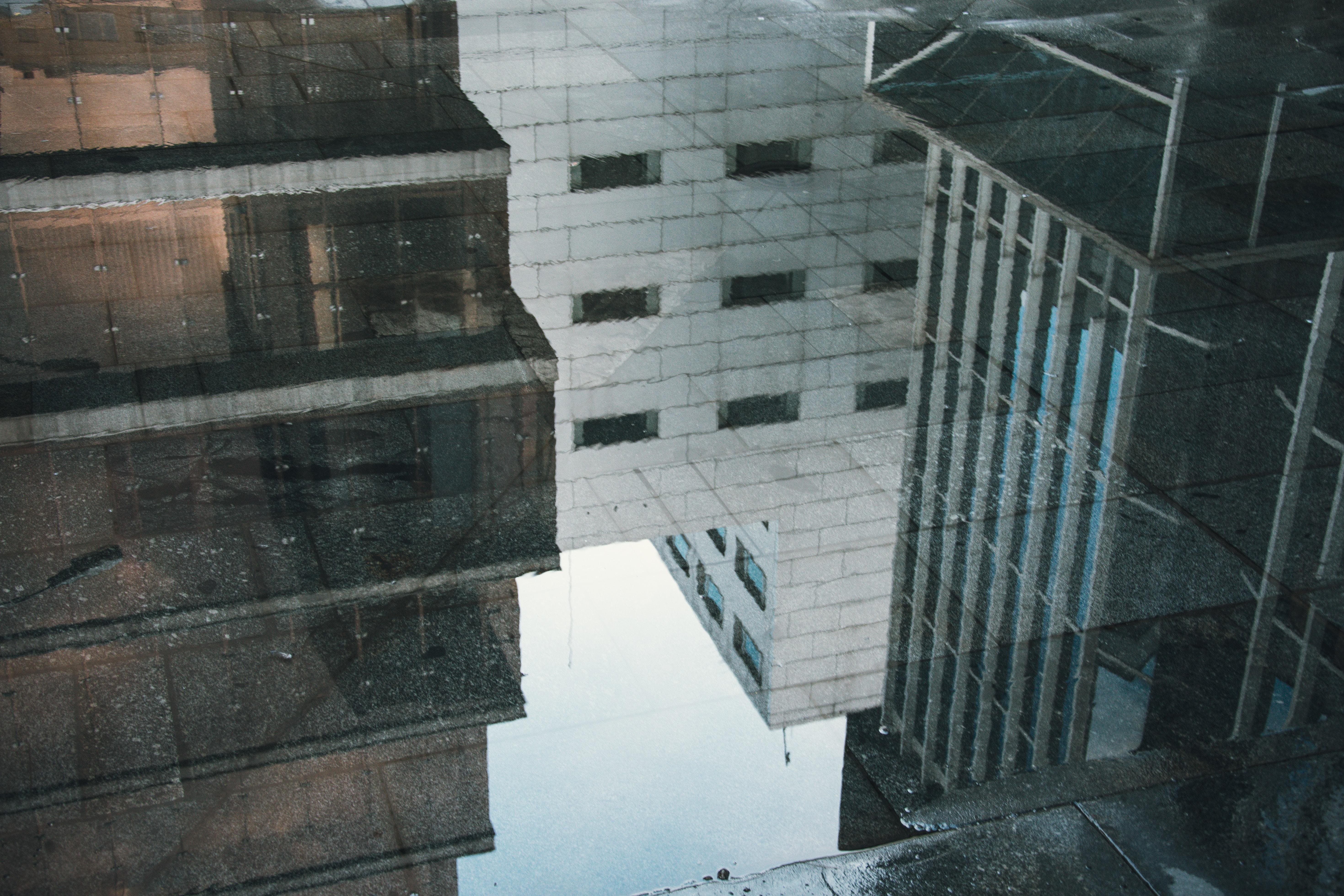 reflection of buildings in water on floor