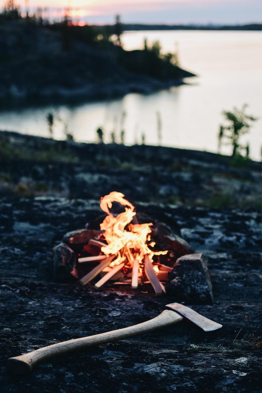 mini bonfire beside a hatchet