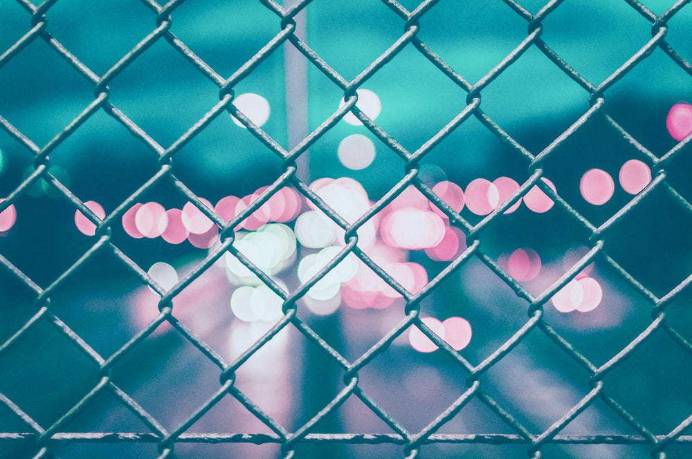 chain link fence with bokeh lights