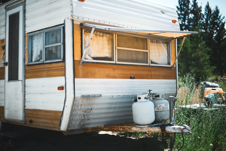 white and gray propane gas tanks on RV trailer