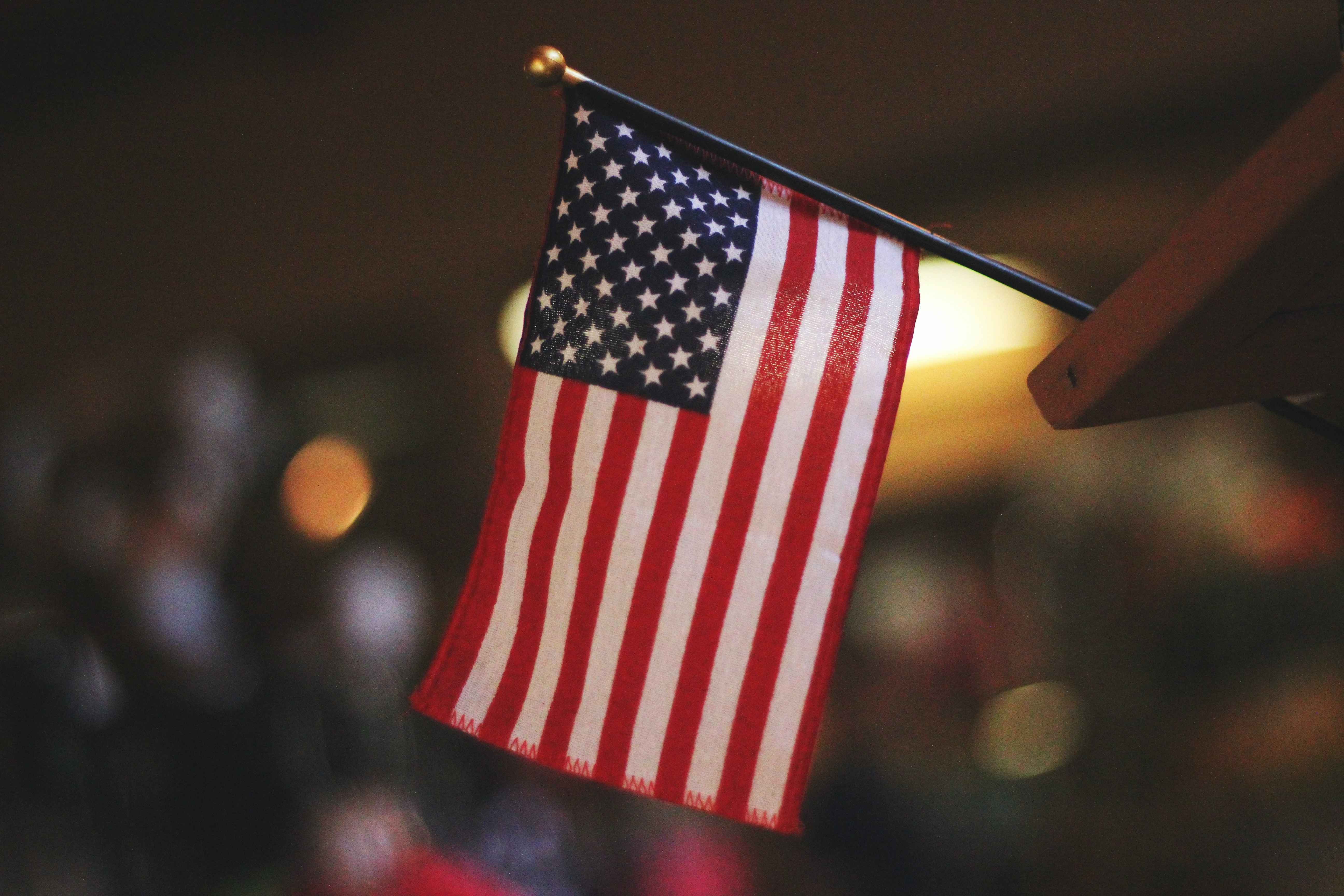 A patriotic American flag sitting on a table as a display of pride