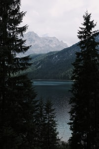 body of water surrounded with mountain