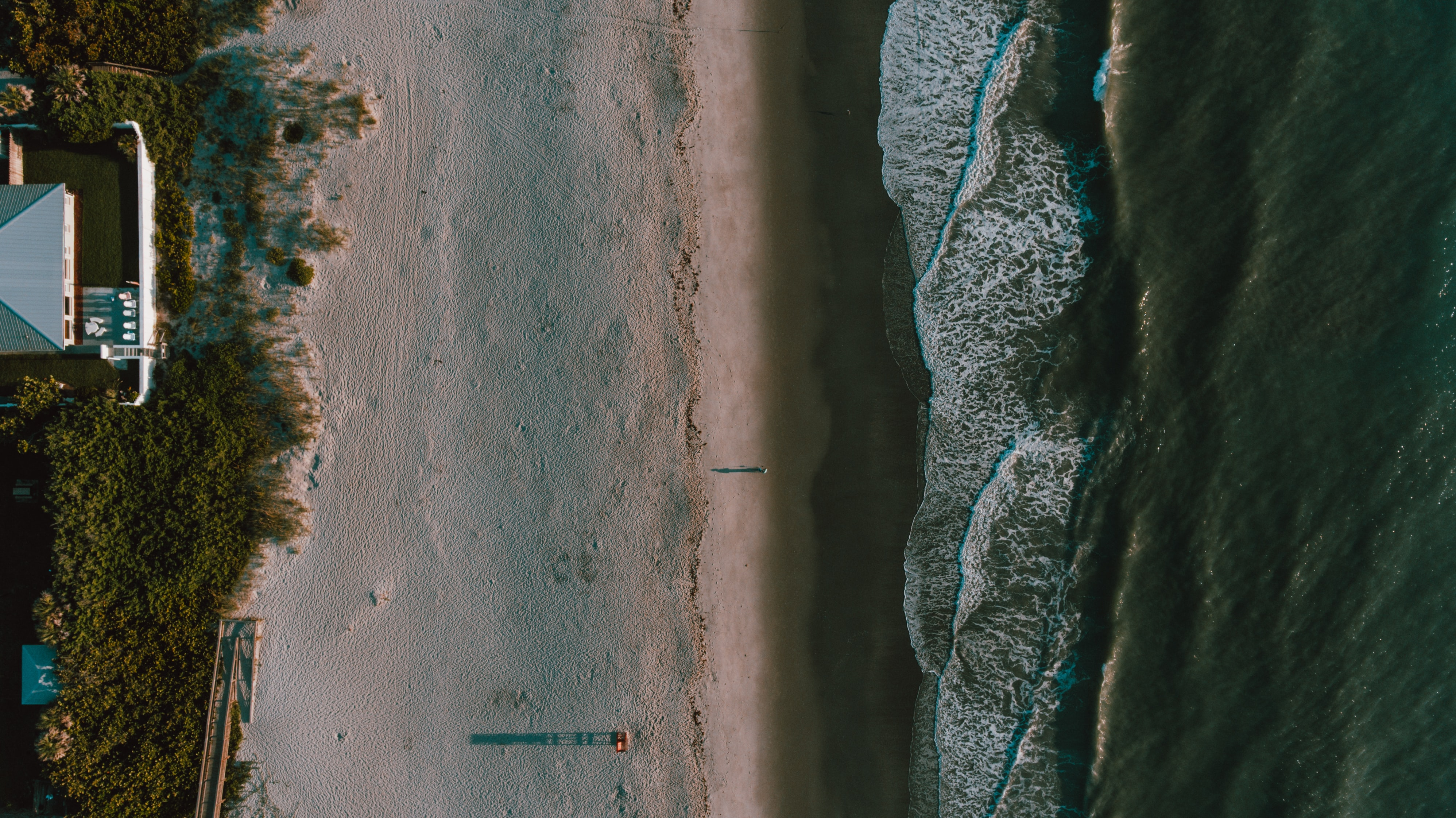 Drone view of the house on the sandy coastline at Melbourne Beach